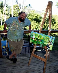 Zion Levy Steward with is Rainforest Rescue Painting for Bio Pack Series
